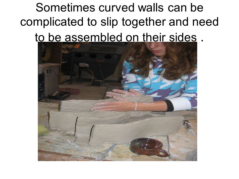 Sometimes curved walls can be complicated to slip together and need to be assembled on their sides .