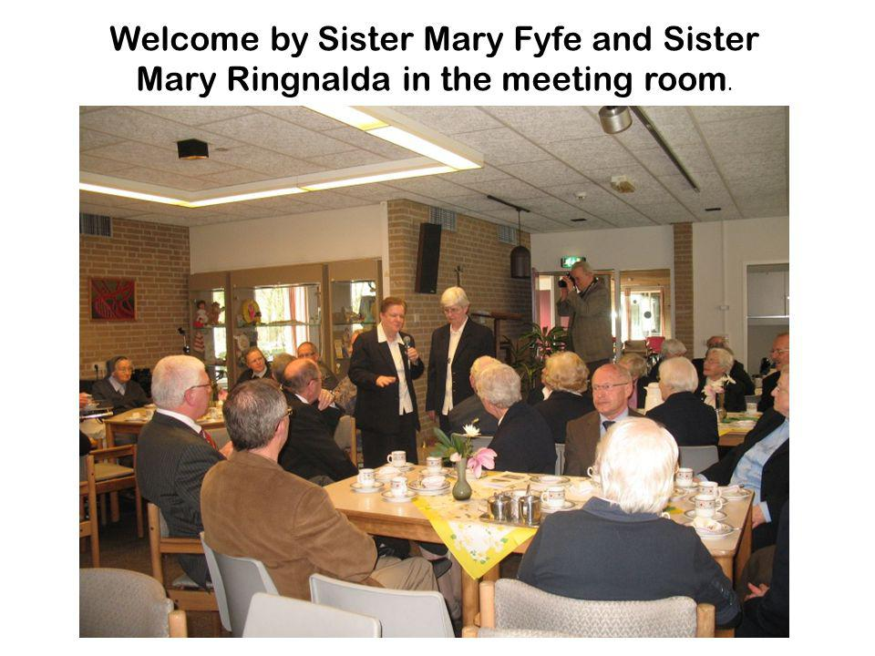 Welcome by Sister Mary Fyfe and Sister Mary Ringnalda in the meeting room.