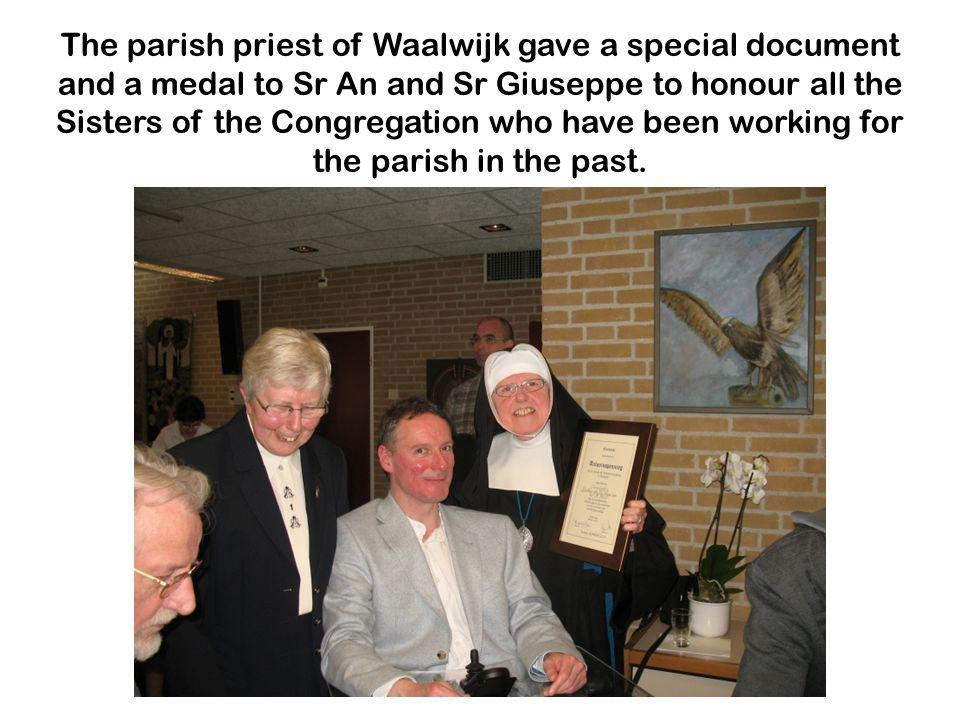 The parish priest of Waalwijk gave a special document and a medal to Sr An and Sr Giuseppe to honour all the Sisters of the Congregation who have been working for the parish in the past.