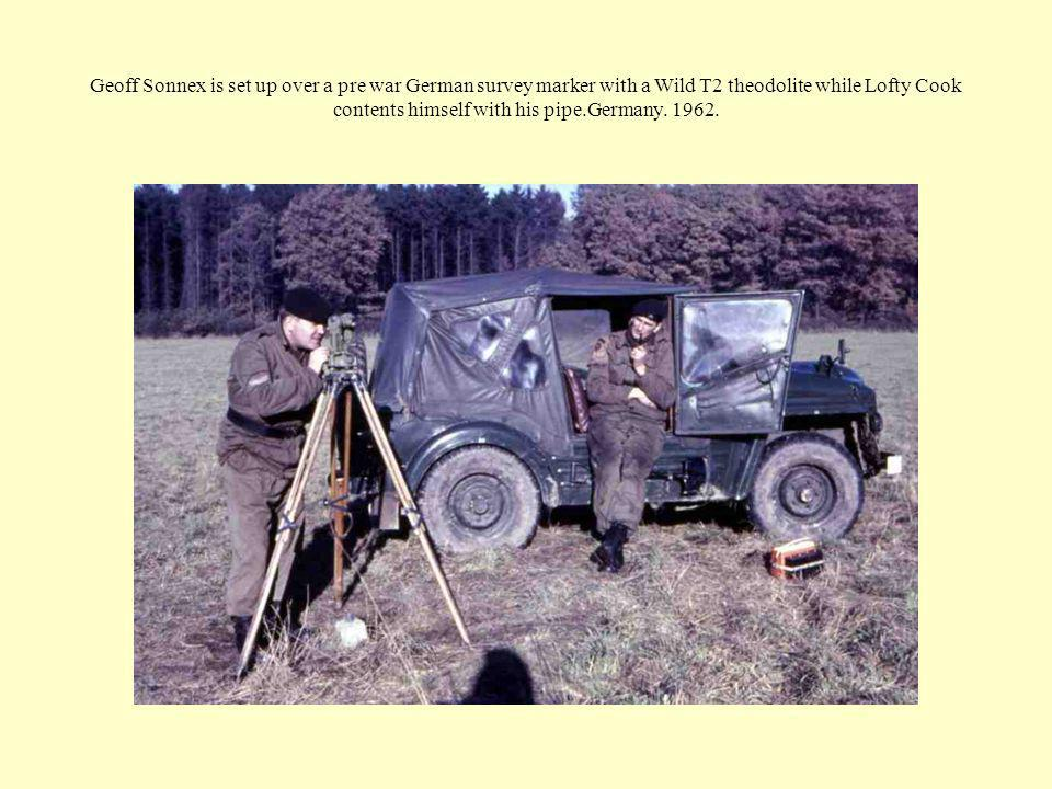 Geoff Sonnex is set up over a pre war German survey marker with a Wild T2 theodolite while Lofty Cook contents himself with his pipe.Germany.