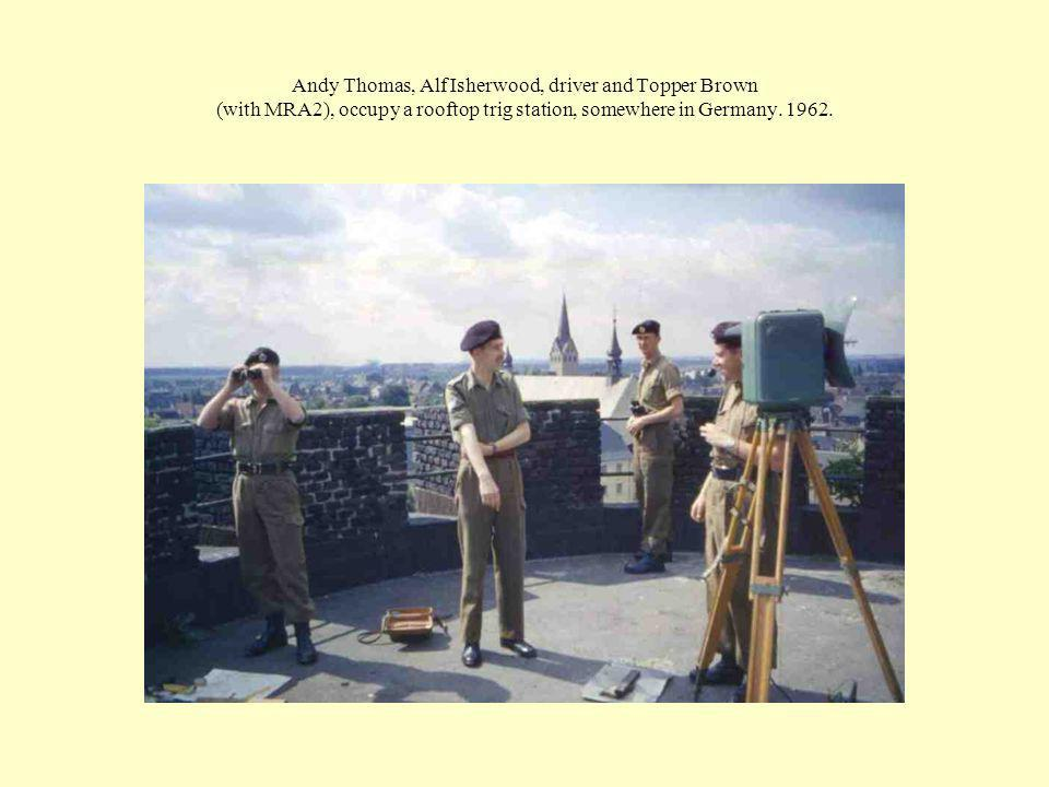 Andy Thomas, Alf Isherwood, driver and Topper Brown (with MRA2), occupy a rooftop trig station, somewhere in Germany.