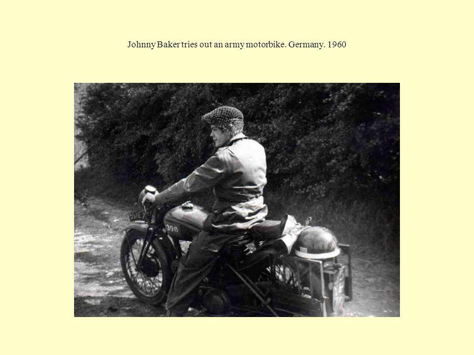 Johnny Baker tries out an army motorbike. Germany. 1960