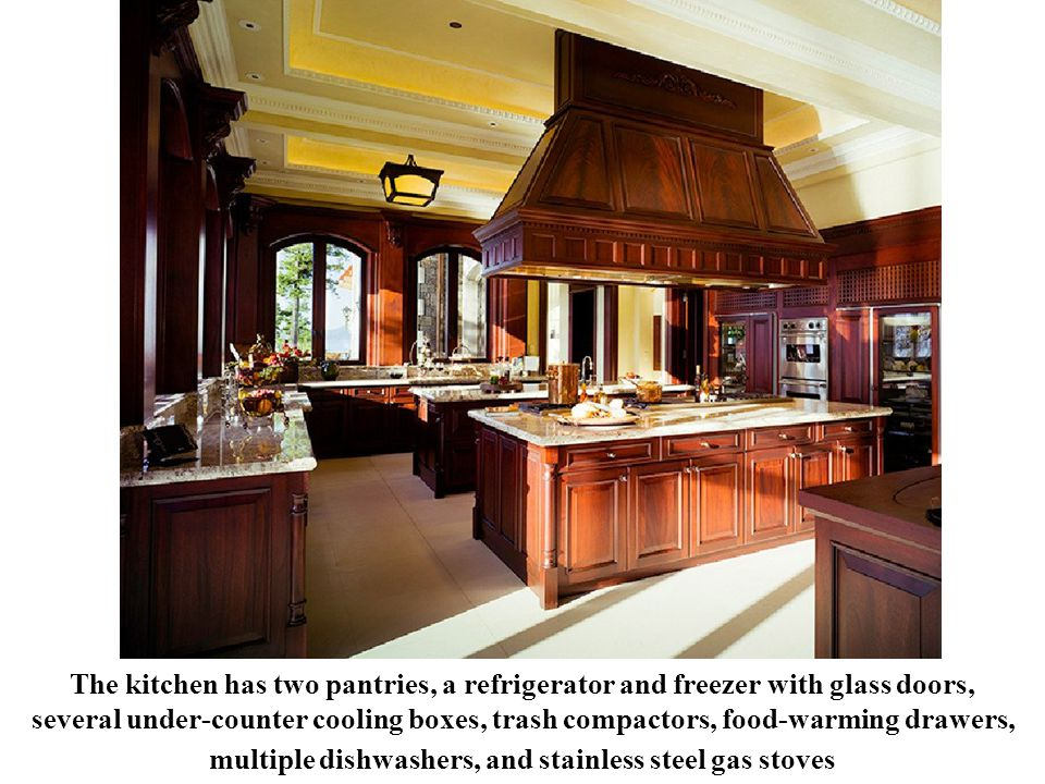 The kitchen has two pantries, a refrigerator and freezer with glass doors, several under-counter cooling boxes, trash compactors, food-warming drawers, multiple dishwashers, and stainless steel gas stoves