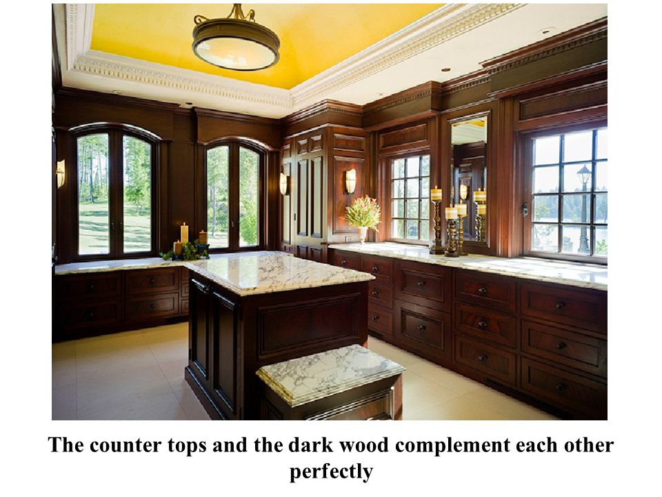 The counter tops and the dark wood complement each other perfectly