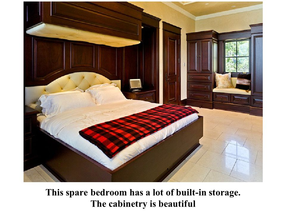 This spare bedroom has a lot of built-in storage