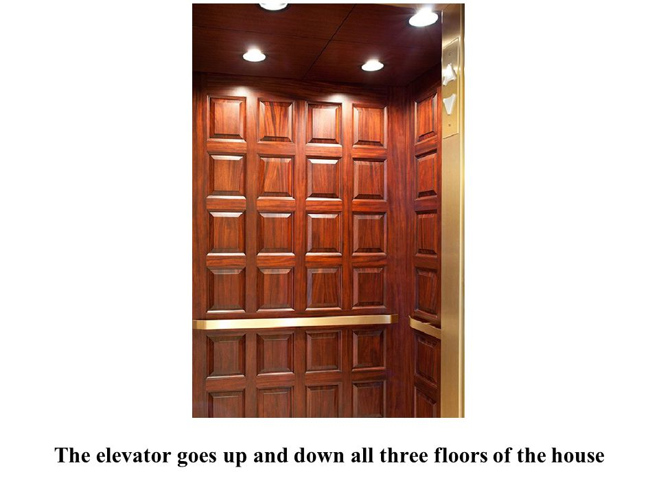 The elevator goes up and down all three floors of the house