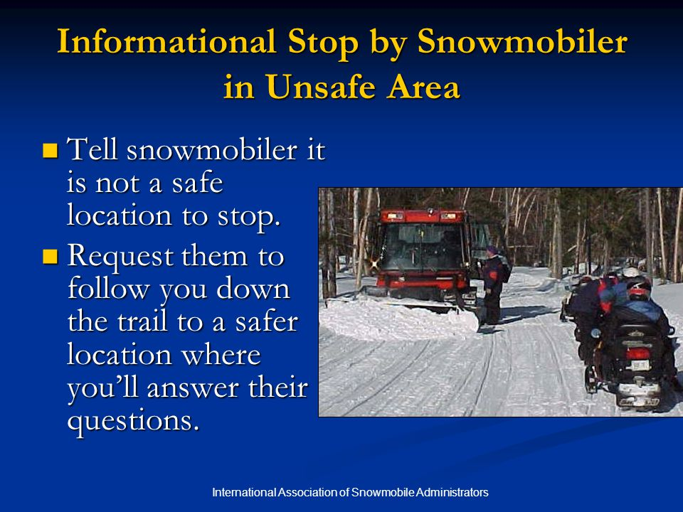 Informational Stop by Snowmobiler in Unsafe Area