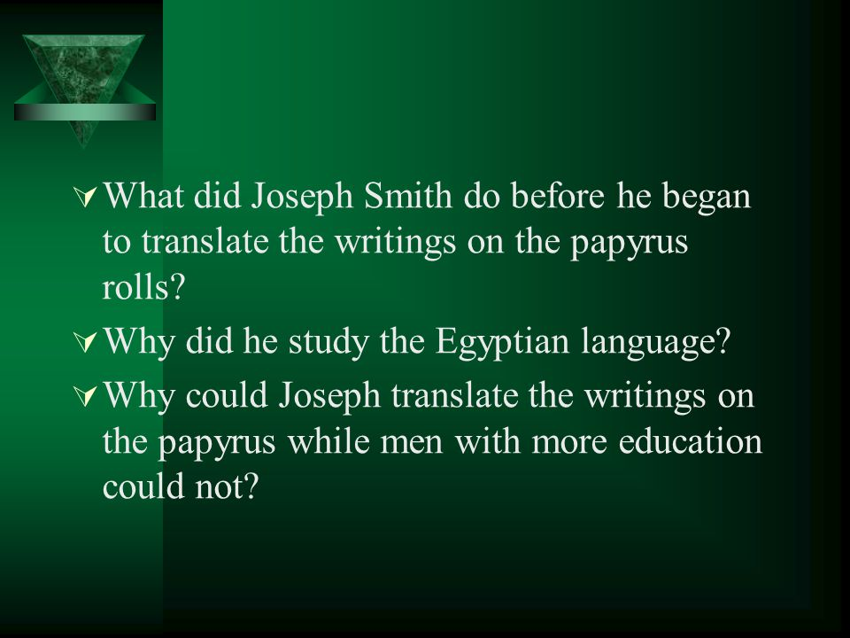 What did Joseph Smith do before he began to translate the writings on the papyrus rolls