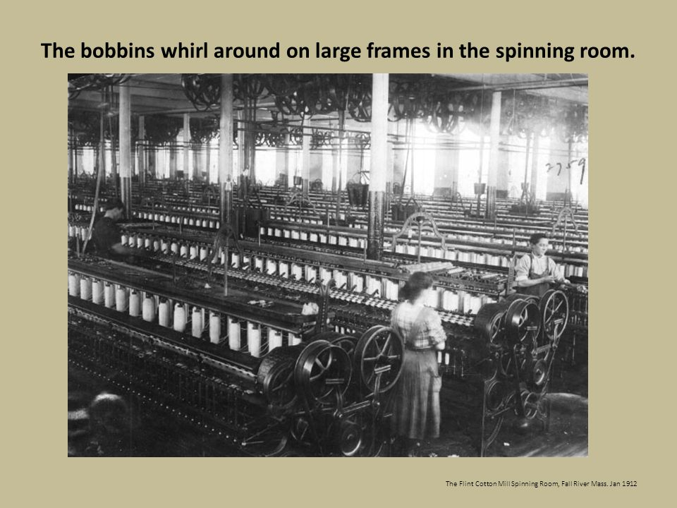 The bobbins whirl around on large frames in the spinning room.