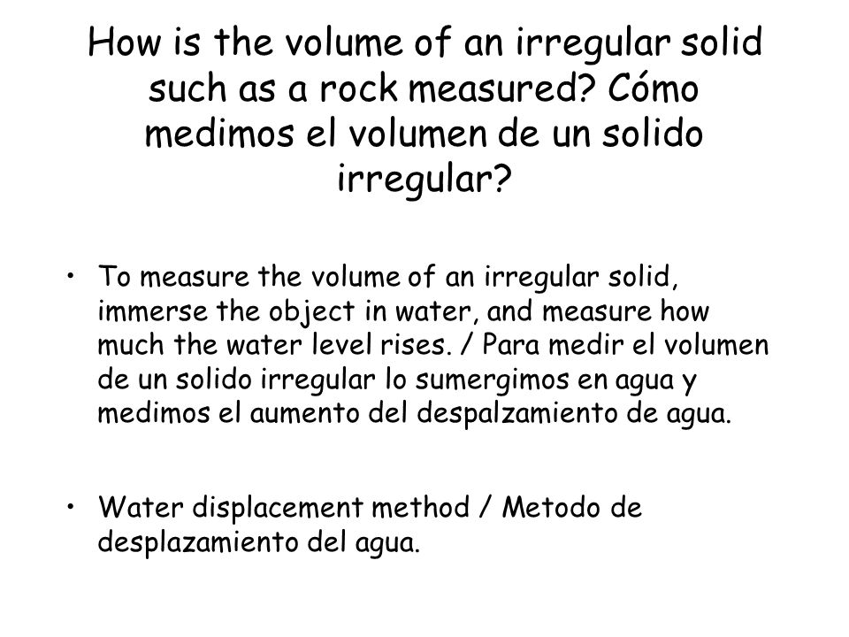 How is the volume of an irregular solid such as a rock measured