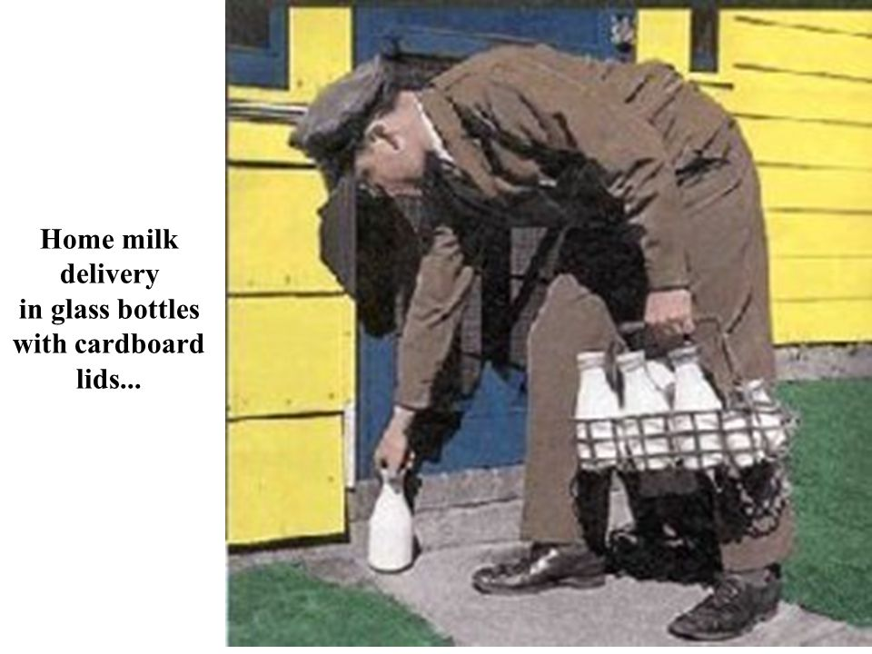 Home milk delivery in glass bottles with cardboard lids...