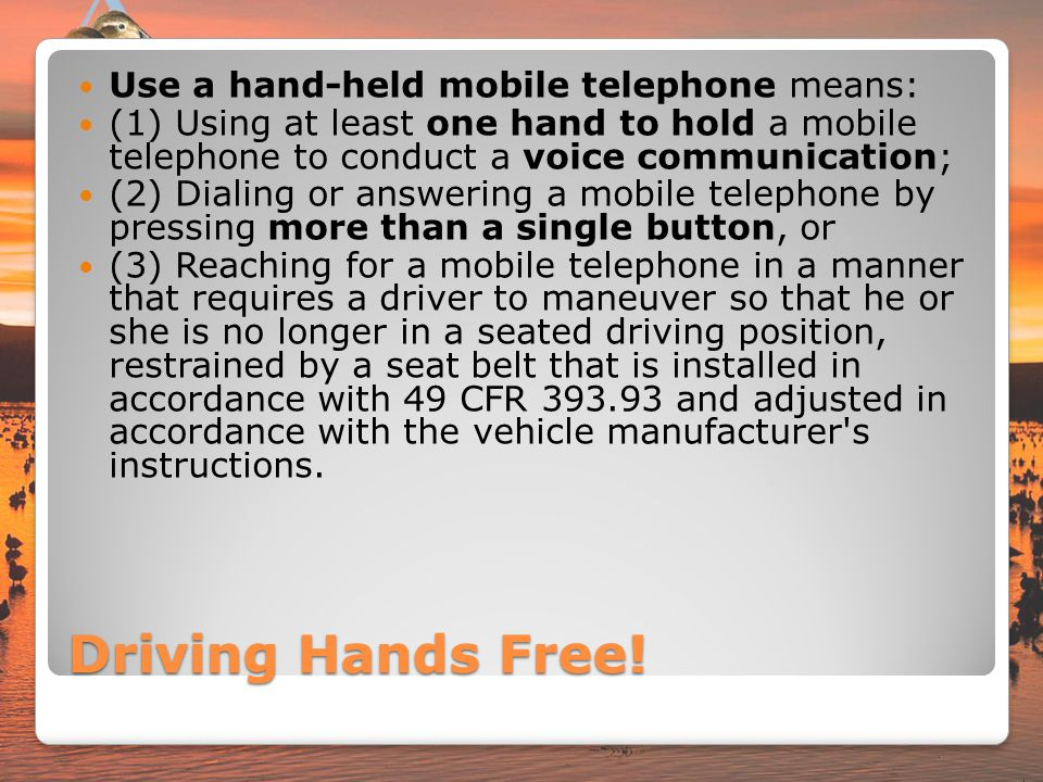 Driving Hands Free! Use a hand-held mobile telephone means: