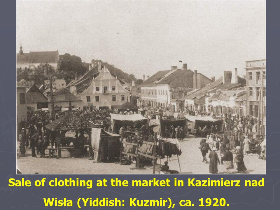 Sale of clothing at the market in Kazimierz nad Wisła (Yiddish: Kuzmir), ca. 1920.