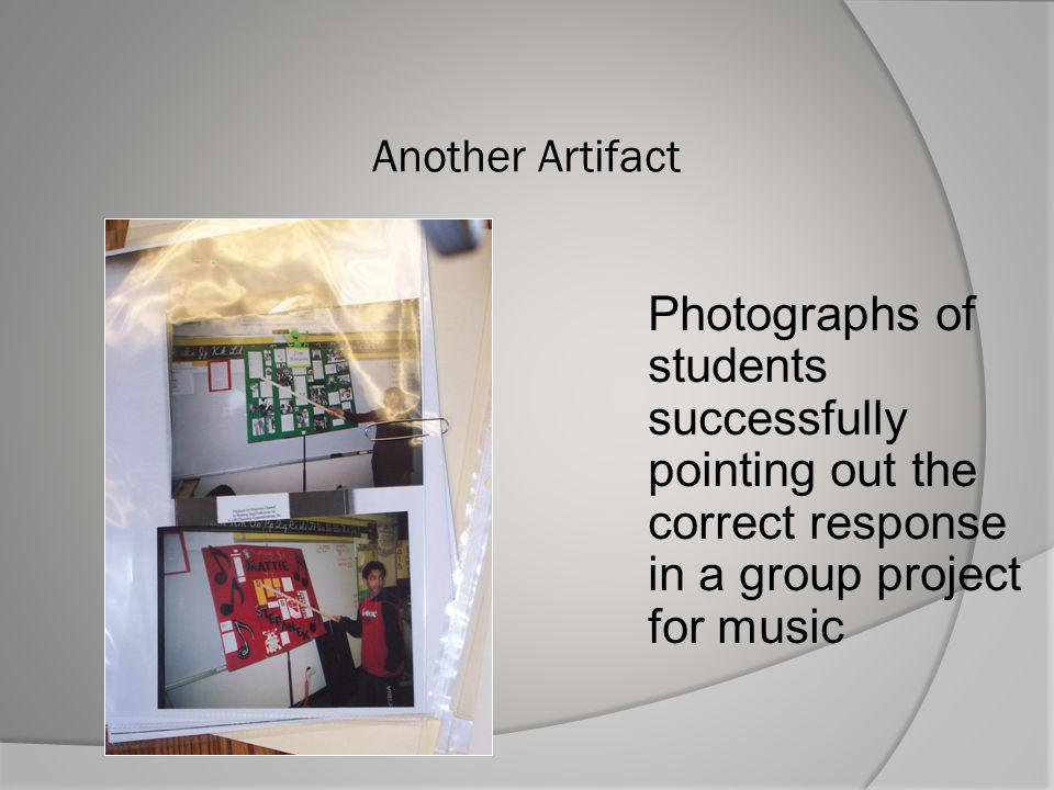 Another Artifact Photographs of students successfully pointing out the correct response in a group project for music.