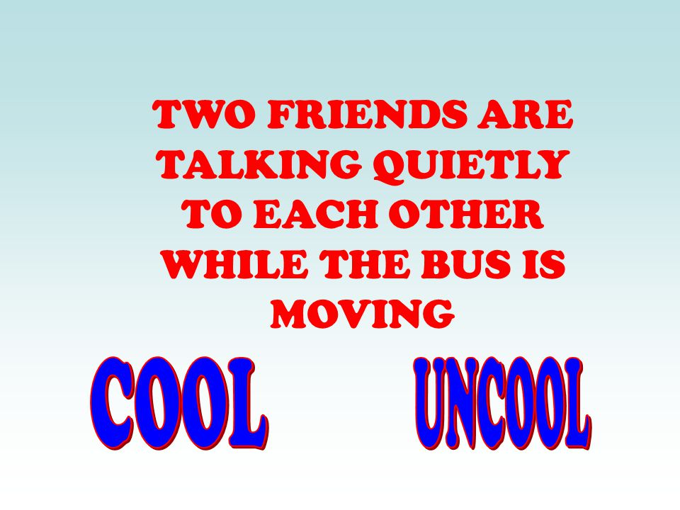 TWO FRIENDS ARE TALKING QUIETLY TO EACH OTHER WHILE THE BUS IS MOVING