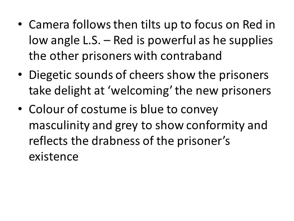 Camera follows then tilts up to focus on Red in low angle L. S