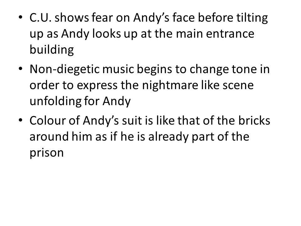 C.U. shows fear on Andy's face before tilting up as Andy looks up at the main entrance building