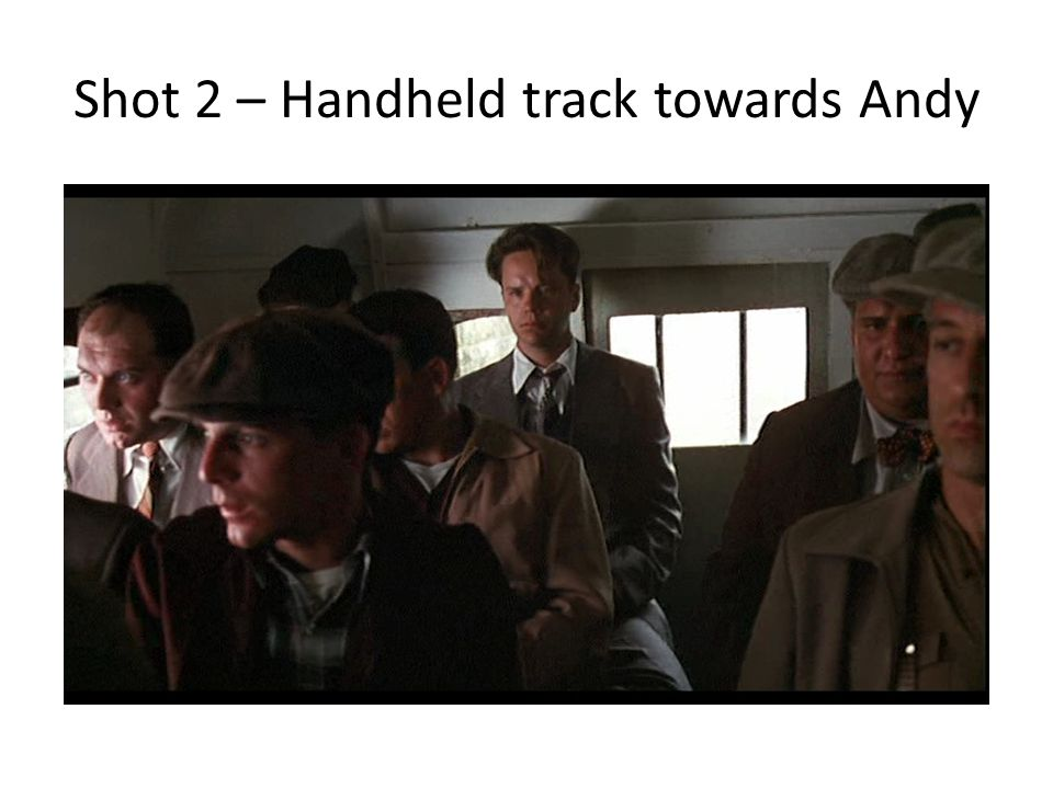 Shot 2 – Handheld track towards Andy