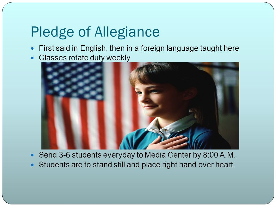Pledge of Allegiance First said in English, then in a foreign language taught here. Classes rotate duty weekly.