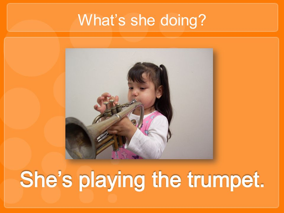 She's playing the trumpet.