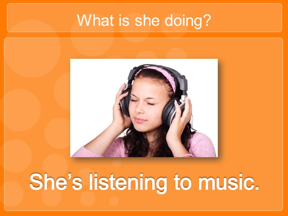 She's listening to music.