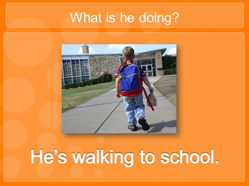 What is he doing He's walking to school.