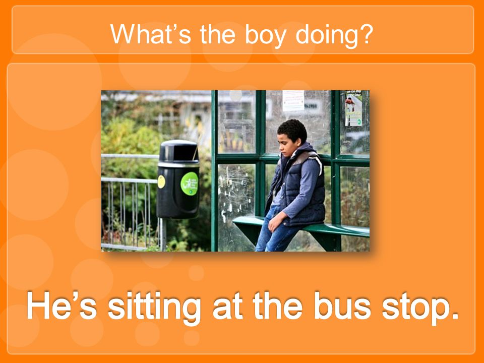 He's sitting at the bus stop.