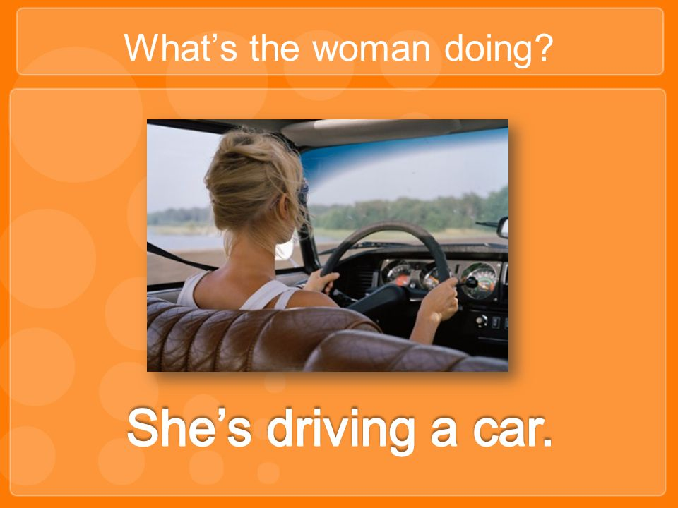 What's the woman doing She's driving a car.