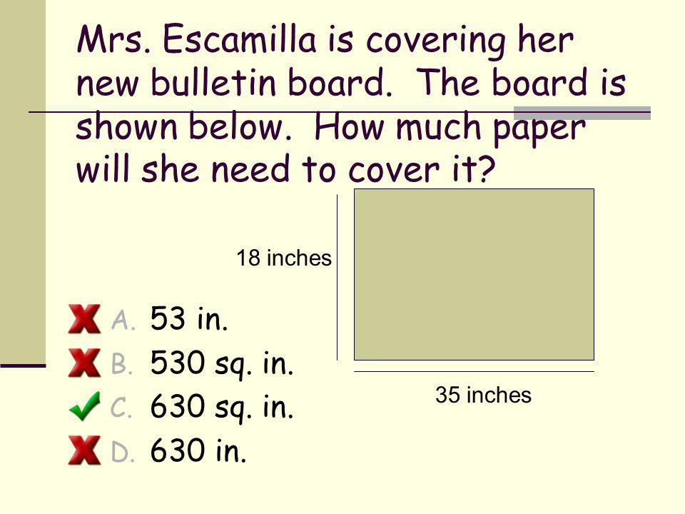 Mrs. Escamilla is covering her new bulletin board
