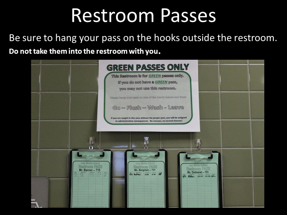 Picture of passes hanging outside restrooms