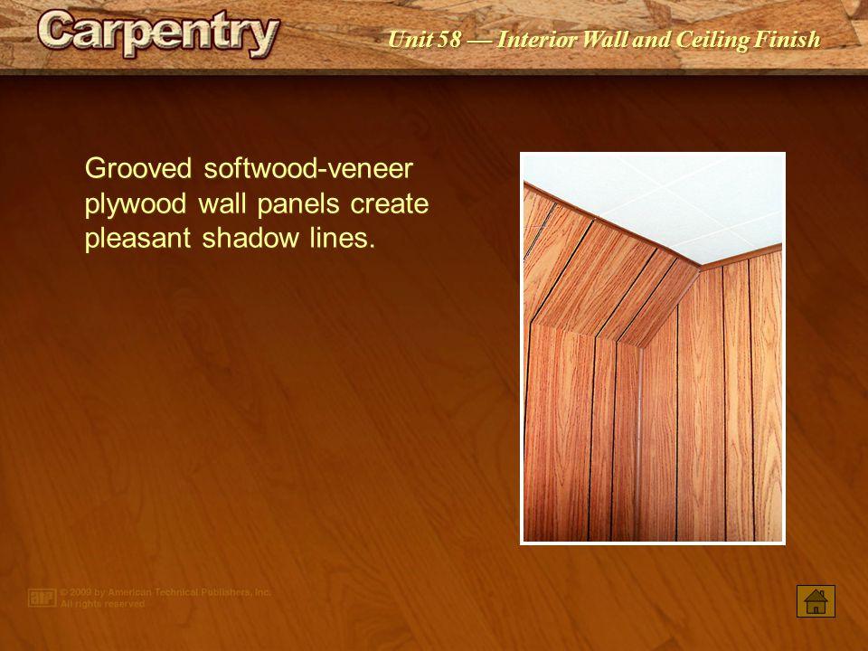 Grooved softwood-veneer plywood wall panels create pleasant shadow lines.