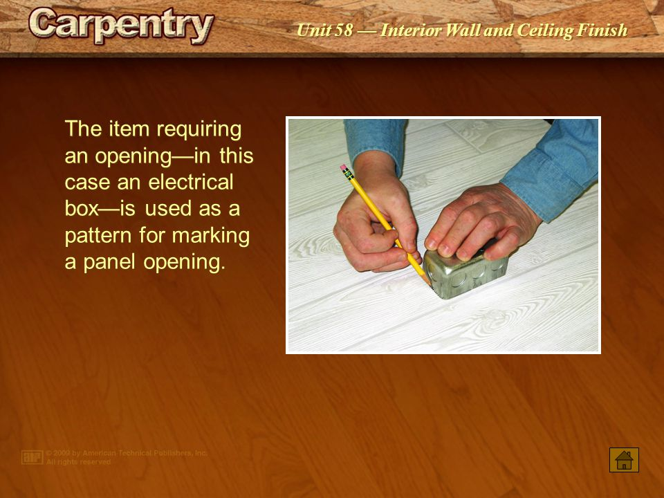 The item requiring an opening—in this case an electrical box—is used as a pattern for marking a panel opening.