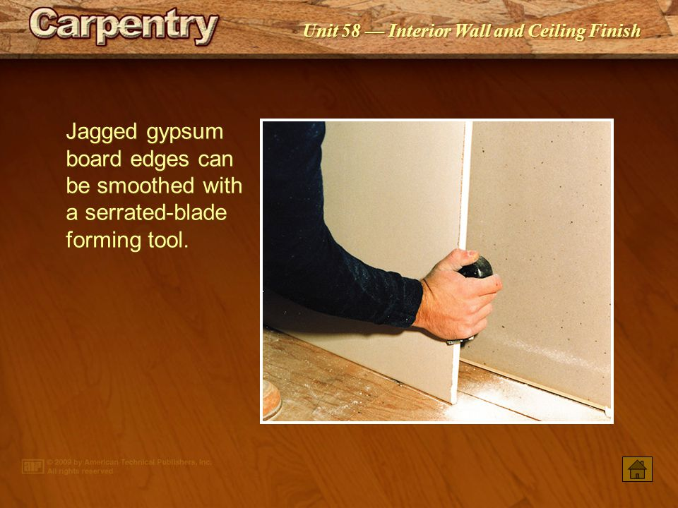 Jagged gypsum board edges can be smoothed with a serrated-blade forming tool.