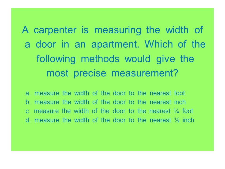 A carpenter is measuring the width of