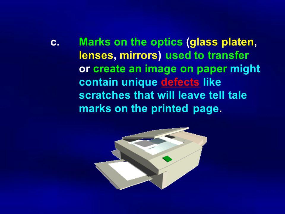 c. Marks on the optics (glass platen,