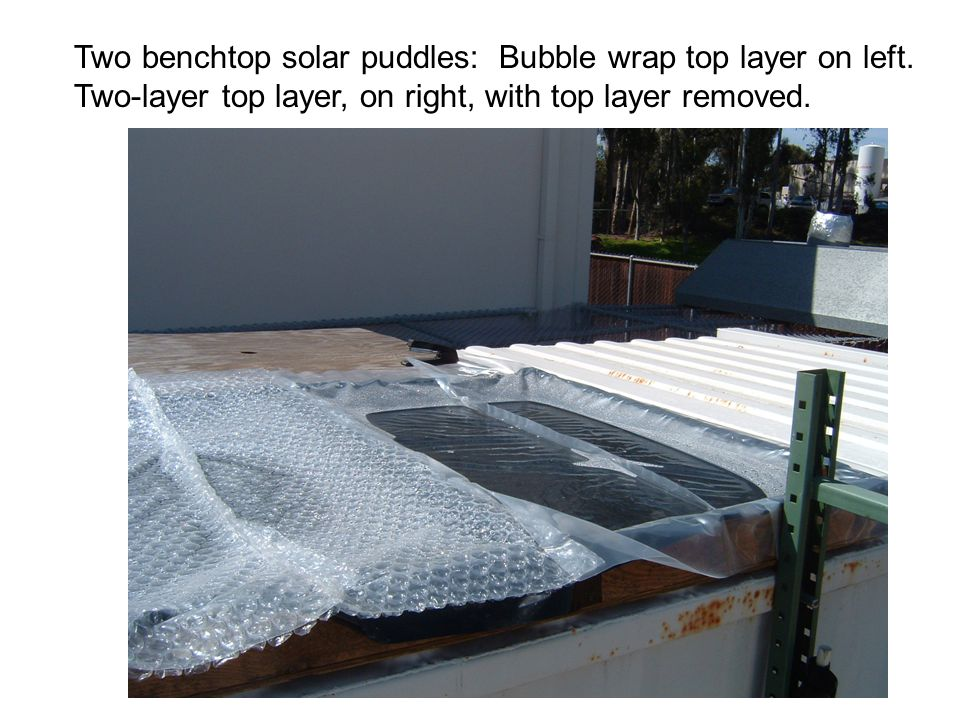 Two benchtop solar puddles: Bubble wrap top layer on left.