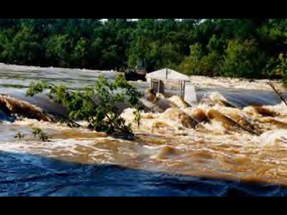 Dam being destroyed by flood waters
