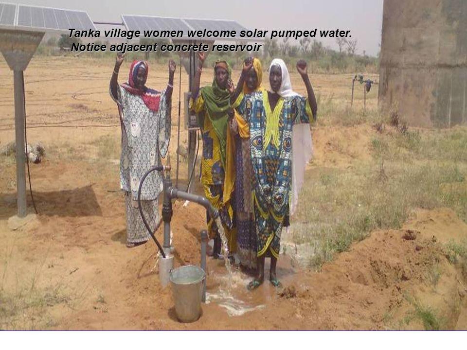 Tanka village women welcome solar pumped water.