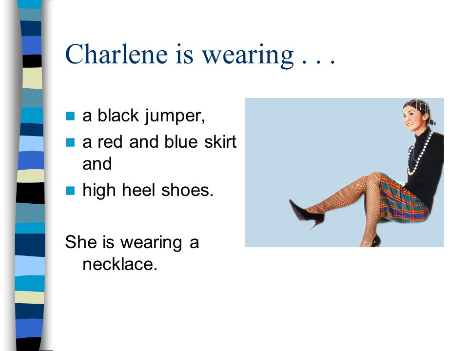 Charlene is wearing a black jumper, a red and blue skirt and