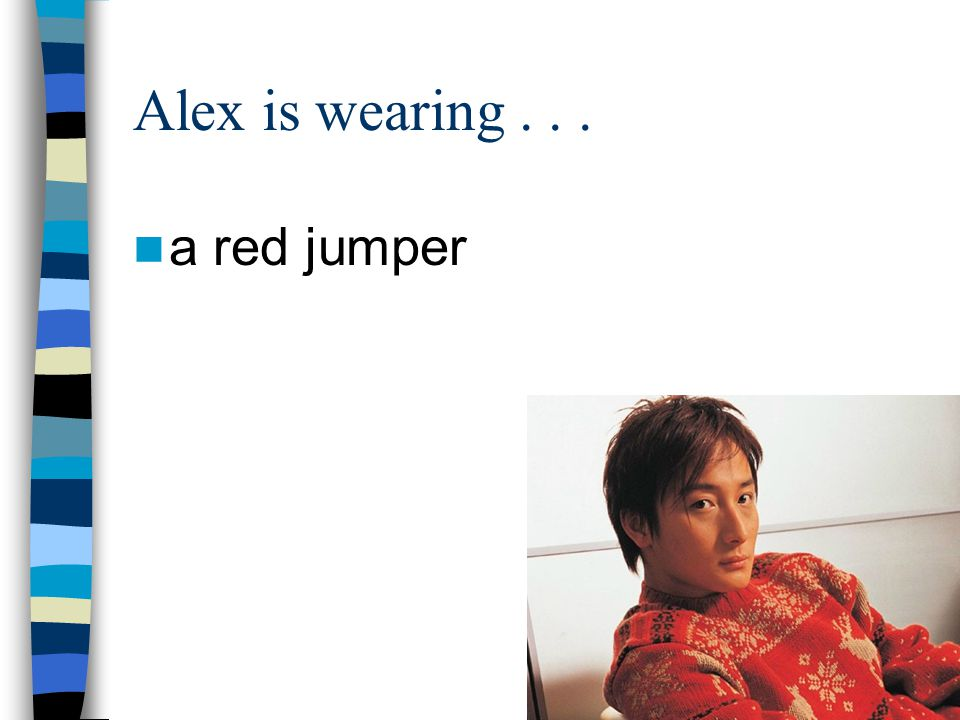 Alex is wearing a red jumper