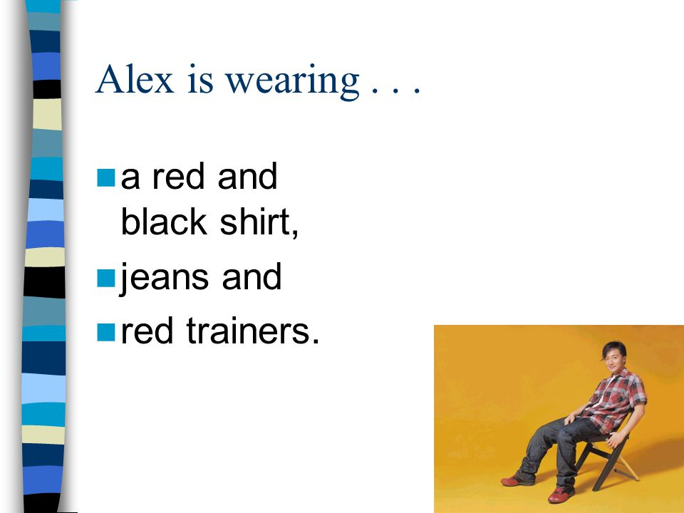 Alex is wearing a red and black shirt, jeans and red trainers.