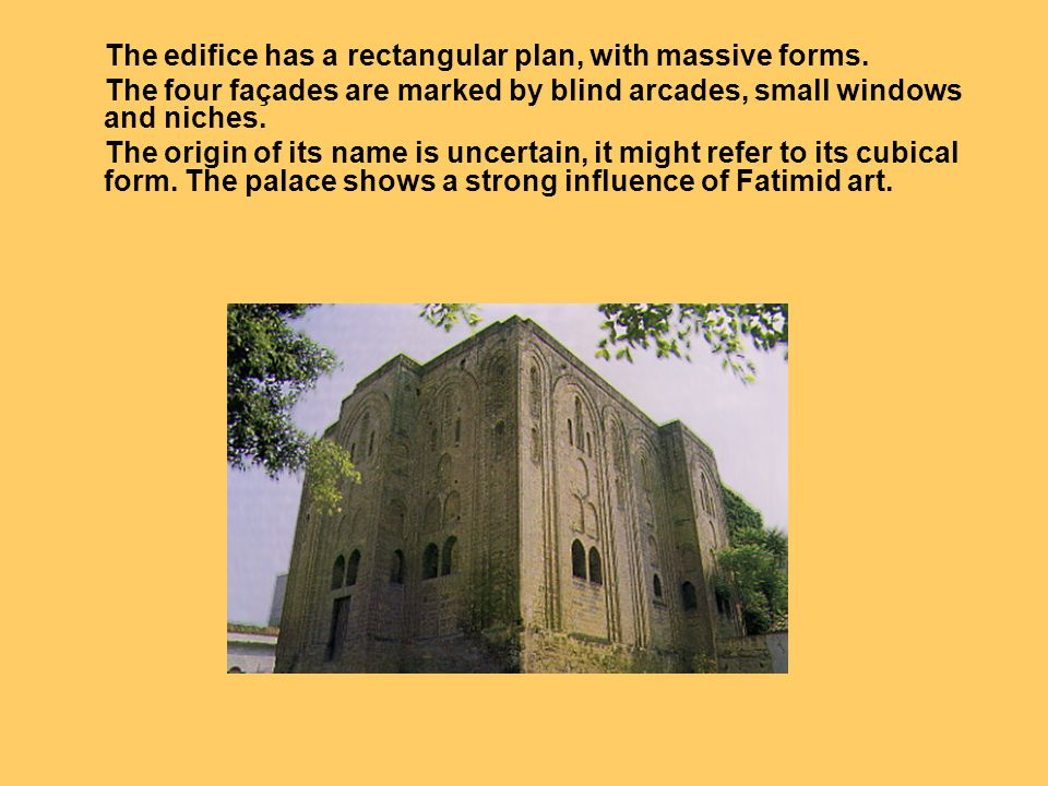 The edifice has a rectangular plan, with massive forms.