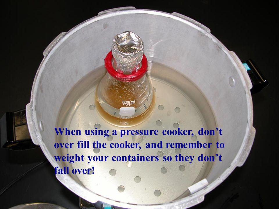 When using a pressure cooker, don't over fill the cooker, and remember to weight your containers so they don't fall over!