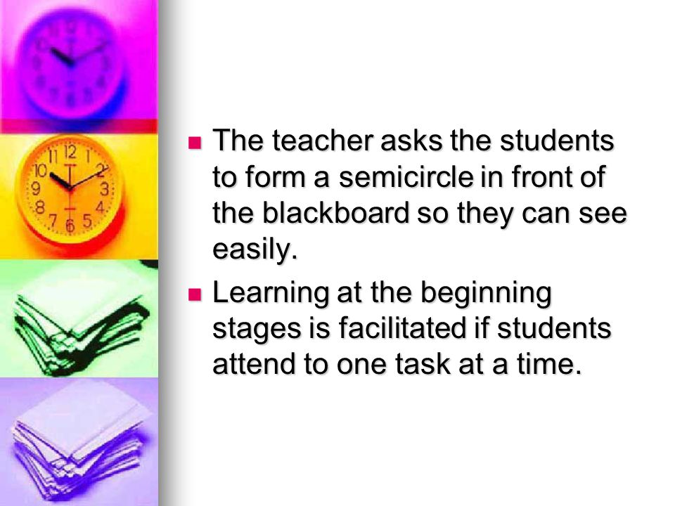 The teacher asks the students to form a semicircle in front of the blackboard so they can see easily.