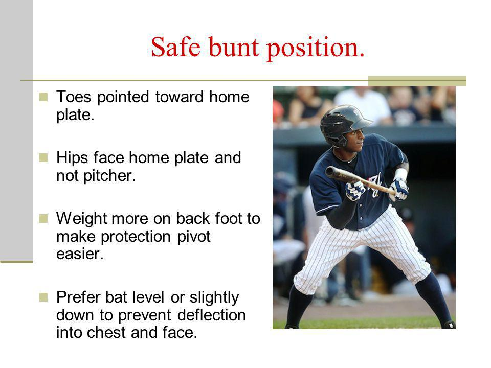 Safe bunt position. Toes pointed toward home plate.