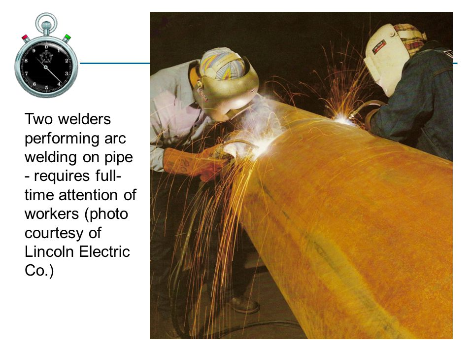 Two welders performing arc welding on pipe - requires full-time attention of workers (photo courtesy of Lincoln Electric Co.)