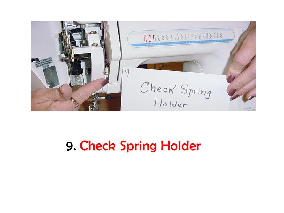 9. Check Spring Holder