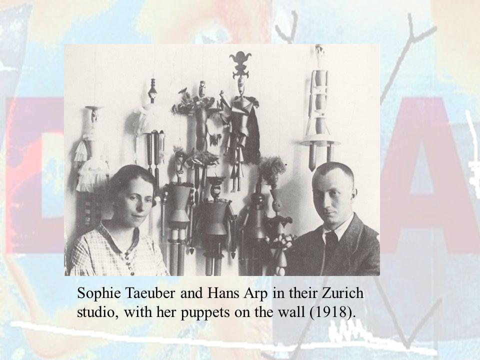 Sophie Taeuber and Hans Arp in their Zurich studio, with her puppets on the wall (1918).