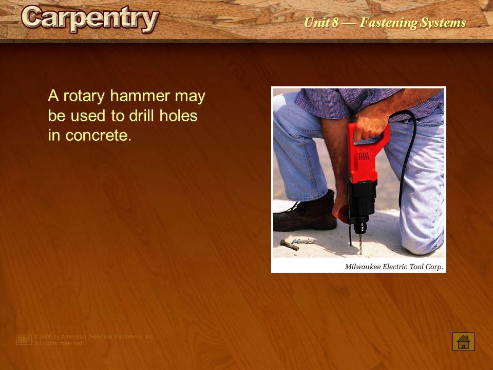 A rotary hammer may be used to drill holes in concrete.