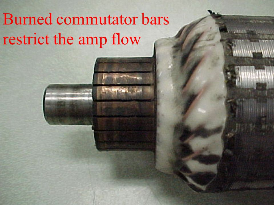 Burned commutator bars restrict the amp flow